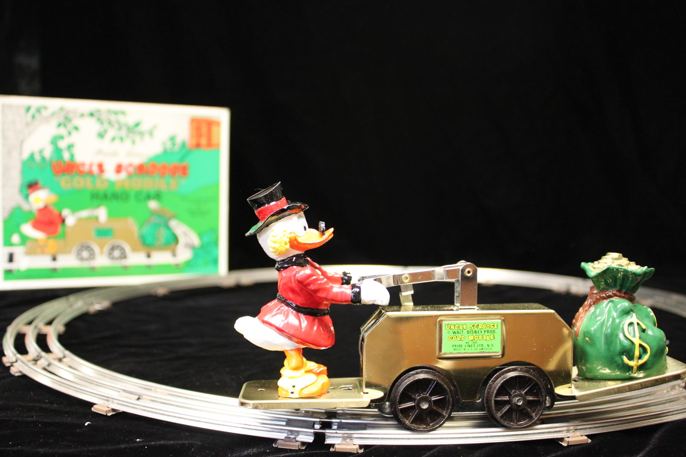 Uncle Scrooge Gold Mobile Hand Car - Primary
